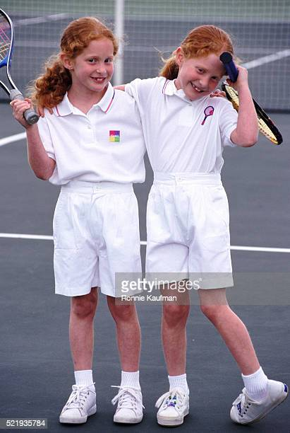 Redheaded twins on the tennis court
