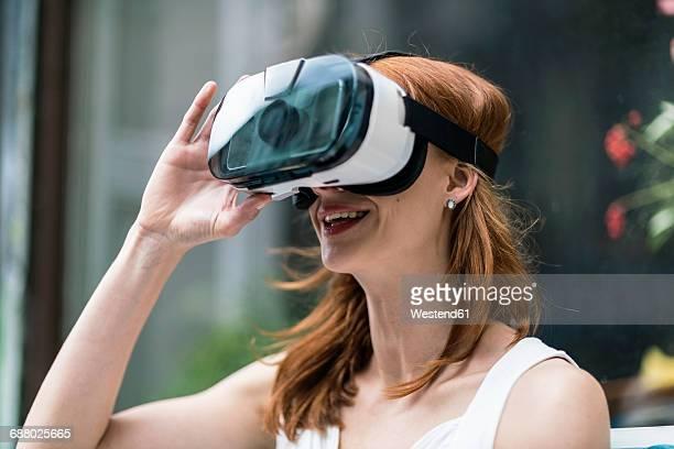 Redheaded woman wearing Virtual Reality Glasses