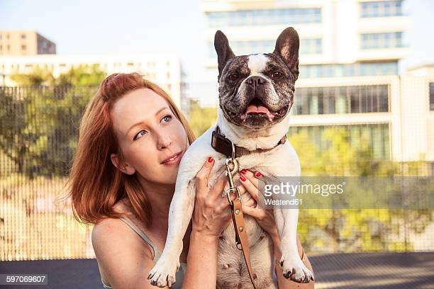 Redheaded woman with her dog