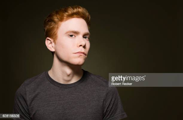 redheaded young man - only young men stock pictures, royalty-free photos & images