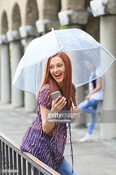 Redheaded young woman enjoying the rainy day