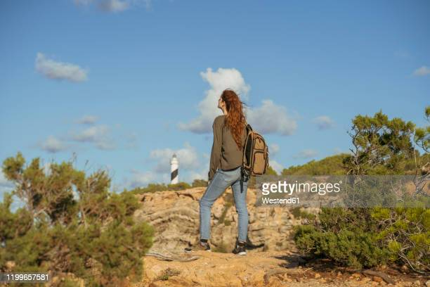 redheaded young woman on a hiking trip, ibiza, spain - islas baleares fotografías e imágenes de stock