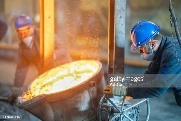 red-hot molten steel - metal industry stock pictures, royalty-free photos & images