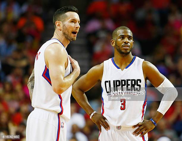 J Redick and Chris Paul of the Los Angeles Clippers wait on the court during their game against the Houston Rockets at the Toyota Center on March 16...