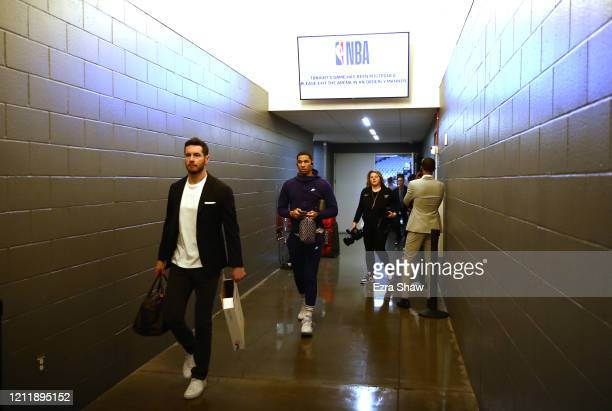 Redick and Josh Hart of the New Orleans Pelicans walk out of the locker room to head to the bus after their game against the Sacramento Kings was...