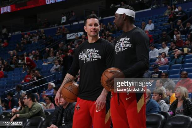 Redick and Jrue Holiday of the New Orleans Pelicans talk prior to a game against the Cleveland Cavaliers on February 28 2020 at the Smoothie King...