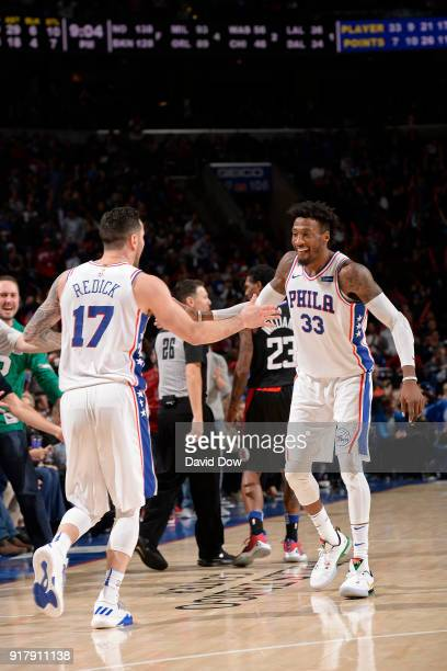 Redick and Robert Covington of the Philadelphia 76ers shake hands against the LA Clippers at Wells Fargo Center on February 10 2018 in Philadelphia...