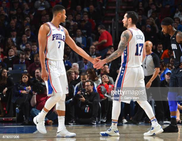 Redick and Timothe LuwawuCabarrot of the Philadelphia 76ers shake hands against the Orlando Magic at Wells Fargo Center on November 25 2017 in...