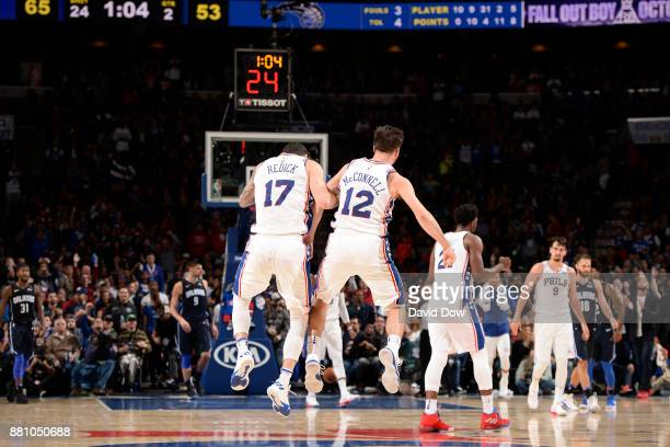 Redick and TJ McConnell of the Philadelphia 76ers celebrate during the game against the Orlando Magic at Wells Fargo Center on November 25 2017 in...