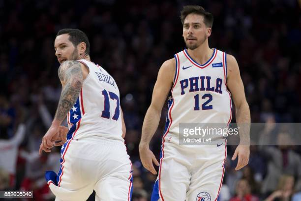 Redick and TJ McConnell of the Philadelphia 76ers look on against the Orlando Magic at the Wells Fargo Center on November 25 2017 in Philadelphia...