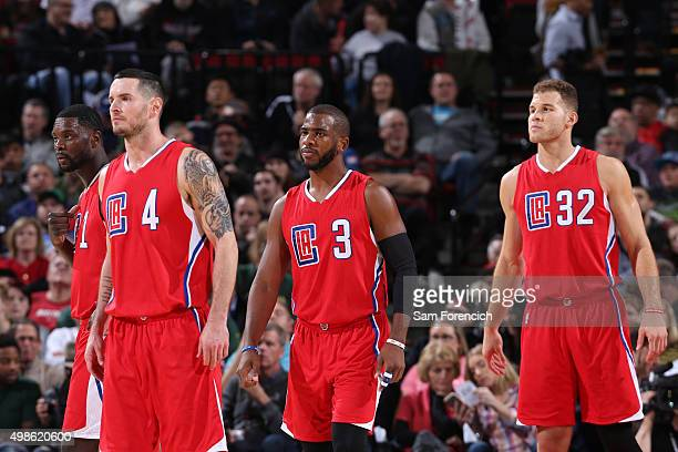J Redick Chris Paul and Blake Griffin of the Los Angeles Clippers walk off the court duinrg the game against the Portland Trail Blazers on November...