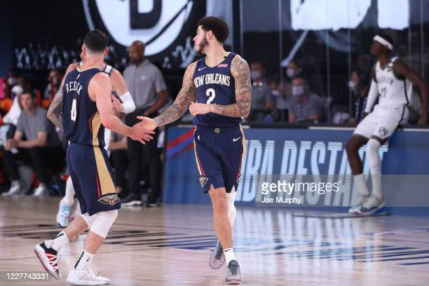 Redick highfives Lonzo Ball of the New Orleans Pelicans on July 22 2020 at The Arena at ESPN Wide World of Sports Complex in Orlando Florida NOTE TO...
