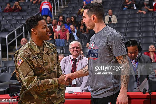 J Redick of the LA Clippers greet a member of the US Army before the game against the Detroit Pistons on November 7 2016 at the STAPLES Center in Los...