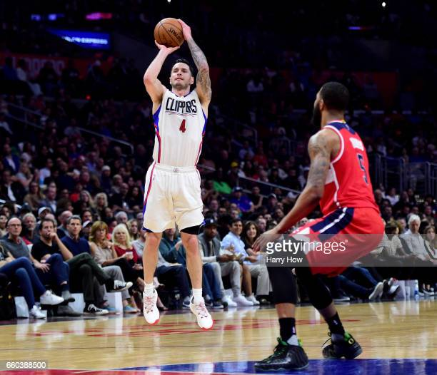Redick of the LA Clippers shoots a three in front of Markieff Morris of the Washington Wizards during a 133124 Clipper win at Staples Center on March...