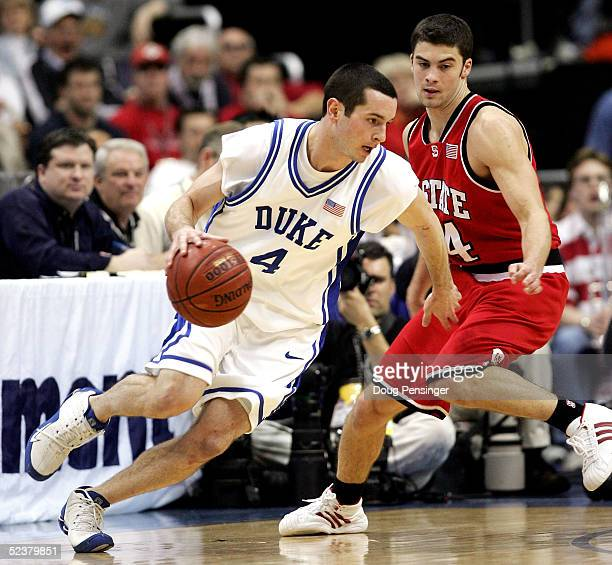 Redick of the Duke Blue Devils drives around Engin Atsur of the North Carolina State Wolfpack during their semi-final ACC Tournament game at the MCI...