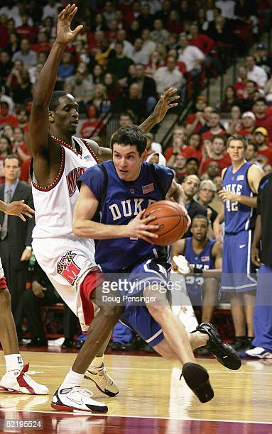 J Redick of the Duke Blue Devils drives past Ikene Ebekwe of the Maryland Terrapins as the Terps defeated the Duke Blue Devils 9992 in overtime...
