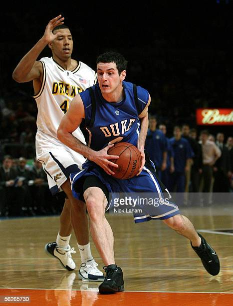 J Redick of the Duke Blue Devils drives to the hoop around Kenny Tribbett of the Drexel Dragons during their Preseason NIT game at Madison Square...