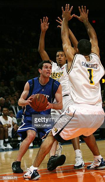 J Redick of the Duke Blue Devils drives to the hoop in front of Kenell Sanchez of the Drexel Dragons during their Preseason NIT game at Madison...