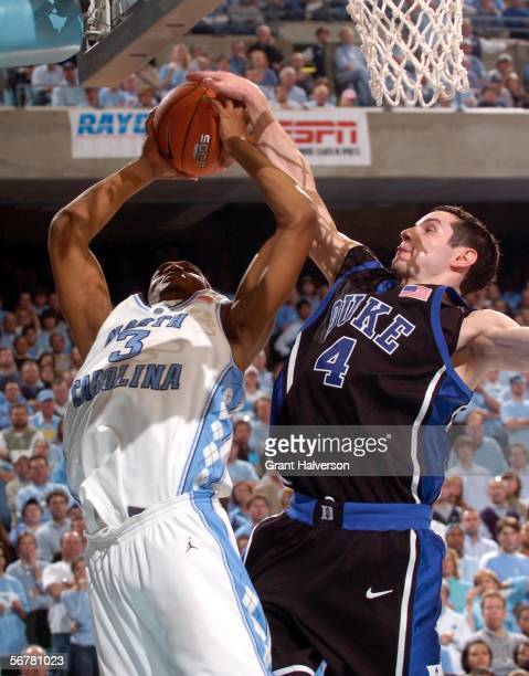 Redick of the Duke Blue Devils fouls Reyshawn Terry of the North Carolina Tar Heels during their game February 7 at the Dean Smith Center in Chapel...