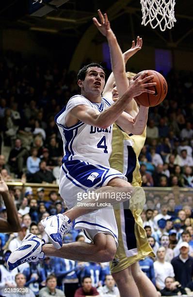 J Redick of the Duke Blue Devils goes under Luke Schenscher during their game on February 5 2005 at Cameron Indoor Stadium in Durham North Carolina