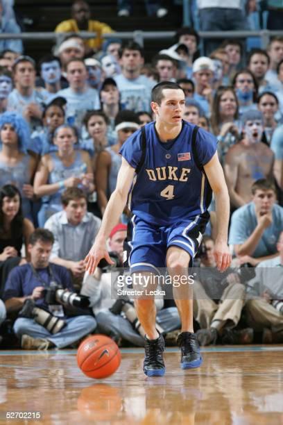 J Redick of the Duke Blue Devils moves the ball during the game against the North Carolina Tar Heels on March 6 2005 at the Dean E Smith Center in...