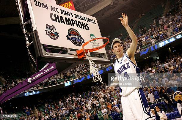 Redick of the Duke Blue Devils salutes the crowd as he cuts down the net after his team's 78-76 win over the Boston College Eagles during the finals...