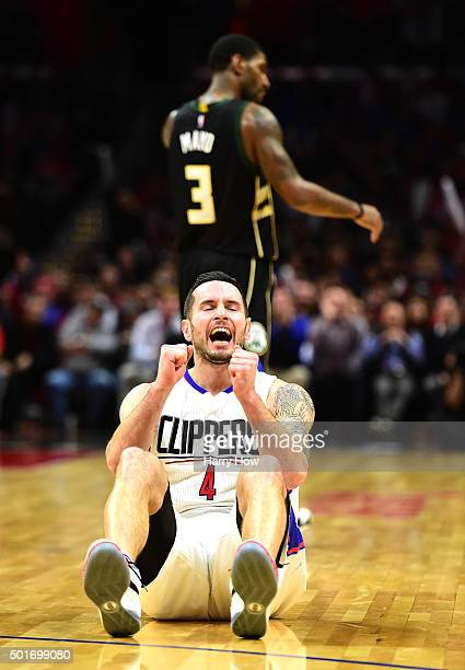 J Redick of the Los Angeles Clippers celebrates his three pointer in front of OJ Mayo of the Milwaukee Bucks during a 10390 Clipper win at Staples...