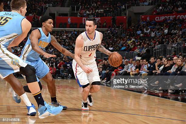 J Redick of the Los Angeles Clippers drives to the basket against the Denver Nuggets during the game on February 24 2016 at STAPLES Center in Los...
