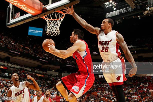 JJ Redick of the Los Angeles Clippers goes for the layup against Shannon Brown of the Miami Heat during the game at the American Airlines Arena in...