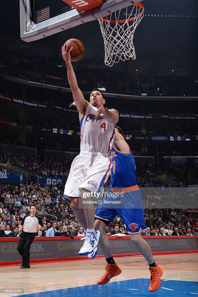 J.J. Redick #4 of the Los Angeles Clippers goes up for a shot against the New York Knicks at Staples Center on November 27, 2013 in Los Angeles, California.
