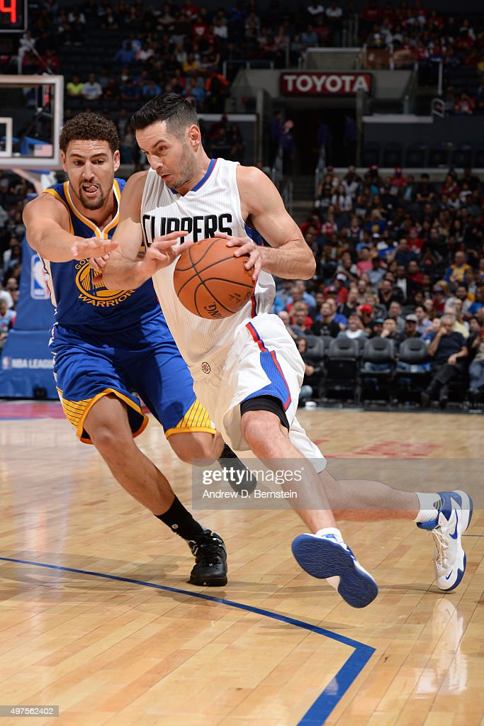 J.J. Redick #4 of the Los Angeles Clippers handles the ball against Klay Thompson #11 of the Golden State Warriors at STAPLES Center on October 20, 2015 in Los Angeles, California.