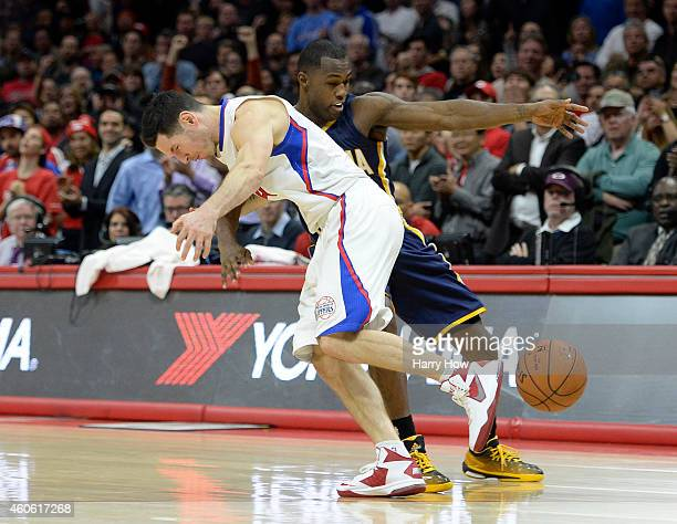 J Redick of the Los Angeles Clippers is fouled by Rodney Stuckey of the Indiana Pacers during a 102100 Clipper win at Staples Center on December 17...