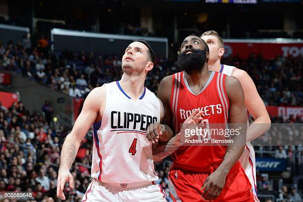 J Redick of the Los Angeles Clippers looks for the rebound against James Harden of the Houston Rockets during the game on January 18 2016 at STAPLES...