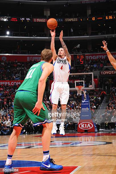 J Redick of the Los Angeles Clippers shoots against the Dallas Mavericks during the game on April 10 2016 at STAPLES Center in Los Angeles California...