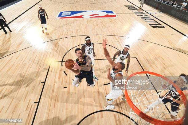 JJ Redick of the New Orleans Pelicans drives to the basket during the game against the Utah Jazz during a game on July 30 2020 at The HP Field House...