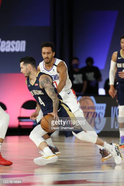 JJ Redick of the New Orleans Pelicans handles the ball against the LA Clippers on August 1 2020 at HP Field House at ESPN Wide World of Sports in...