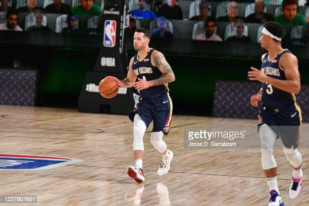 JJ Redick of the New Orleans Pelicans handles the ball during the game against the Milwaukee Bucks during a scrimmage on July 27 2020 at The Arena at...