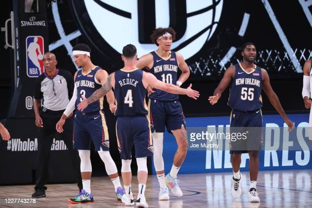Redick of the New Orleans Pelicans highfives teammates during the game on July 22 2020 at The Arena at ESPN Wide World of Sports Complex in Orlando...