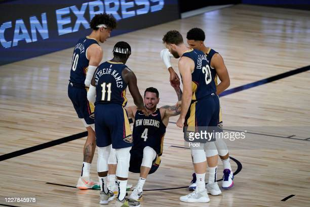 Redick of the New Orleans Pelicans is helped up by teammates during the first half of an NBA basketball game against the Utah Jazz at HP Field House...