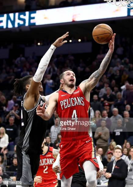Redick of the New Orleans Pelicans makes the game winning shot over Richaun Holmes of the Sacramento Kings in the final seconds of their game at...