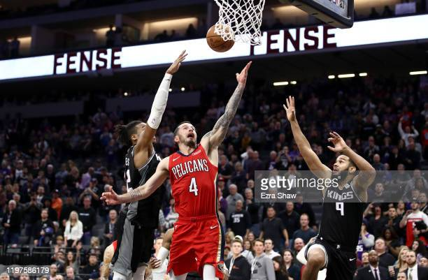 Redick of the New Orleans Pelicans makes the game winning shot over Richaun Holmes and Cory Joseph of the Sacramento Kings in the final seconds of...