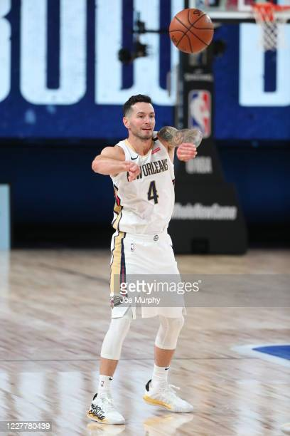 Redick of the New Orleans Pelicans passes the ball against the Denver Nuggets on July 25 2020 at HP Field House at ESPN Wide World of Sports Complex...
