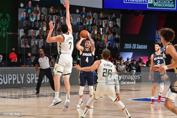 JJ Redick of the New Orleans Pelicans shoots a three point basket during the game against the Milwaukee Bucks during a scrimmage on July 27 2020 at...