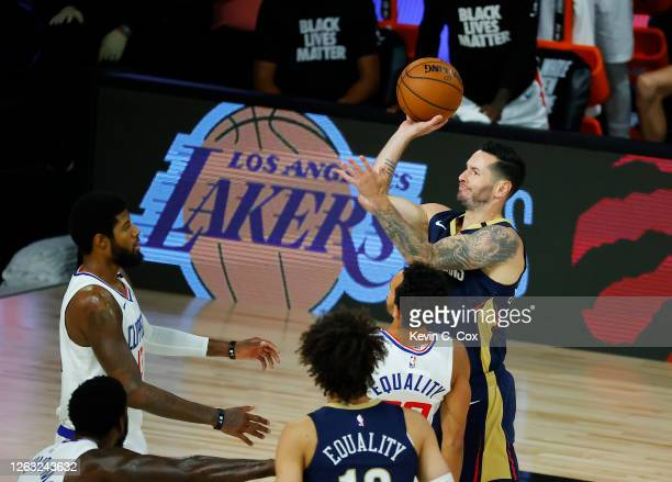 Redick of the New Orleans Pelicans shoots against Paul George of the Los Angeles Clippers at HP Field House at ESPN Wide World Of Sports Complex on...
