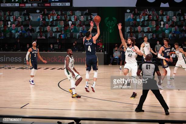 J Redick of the New Orleans Pelicans shoots against the Milwaukee Bucks as part of the NBA Restart 2020 on July 27 2020 at The Arena at ESPN Wide...