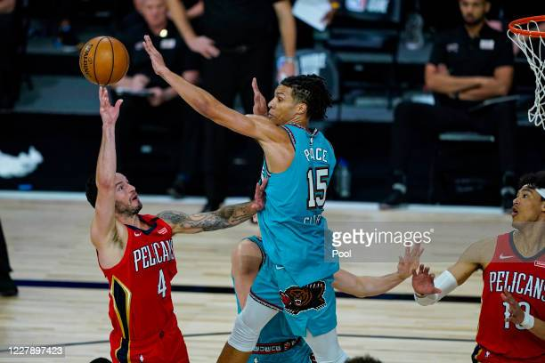 Redick of the New Orleans Pelicans shoots over Brandon Clarke of the Memphis Grizzlies during the second half of an NBA basketball game at HP Field...