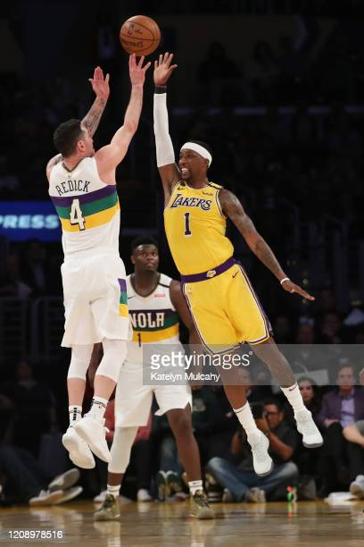 Redick of the New Orleans Pelicans shoots the ball against Kentavious CaldwellPope of the Los Angeles Lakers during the second half at Staples Center...