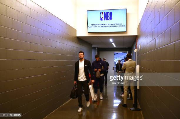 Redick of the New Orleans Pelicans walks out of the locker room to head to the bus after their game against the Sacramento Kings was postponed at...