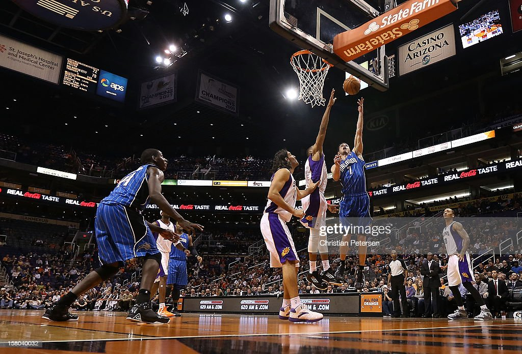 J.J. Redick #7 of the Orlando Magic lays up a shot against the Phoenix Suns during the NBA game at US Airways Center on December 9, 2012 in Phoenix, Arizona.