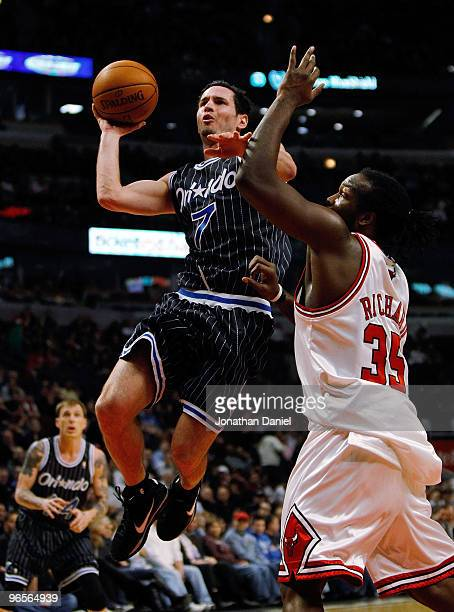 J Redick of the Orlando Magic puts up a shot against Chris Richard of the Chicago Bulls at the United Center on February 10 2010 in Chicago Illinois...